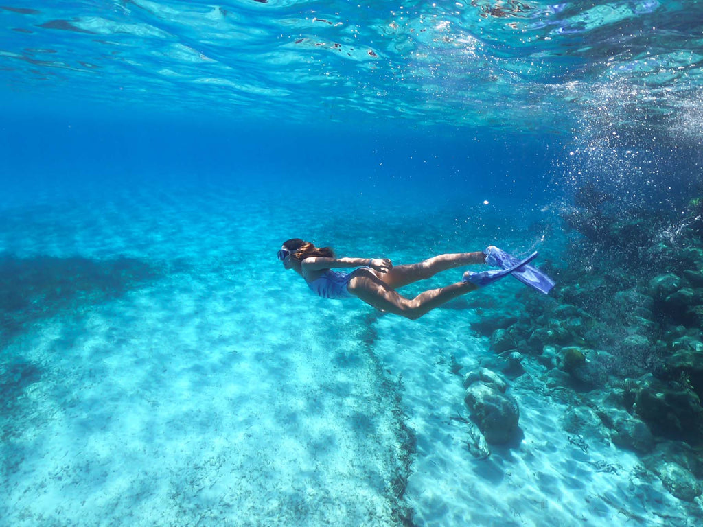 Underwater photography of a girl swimming in the Bahamas