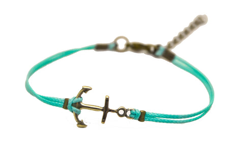 Cord bracelet with a bronze anchor charm, turquoise string