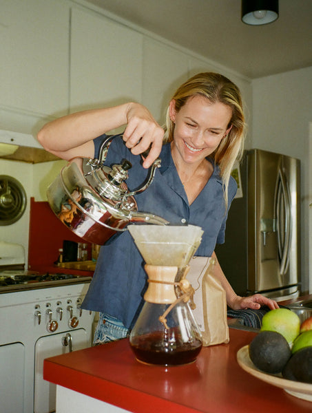 Artist Maureen Meyer making a pour over at her home in Silver Lake with Canyon Coffee