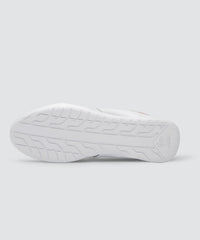 Bottom view of white AKIN driving shoe for car enthusiasts.