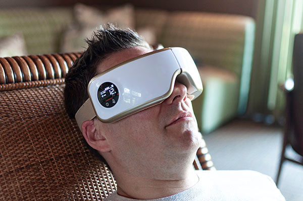 Man relaxes with the Body Sport Eye Massager