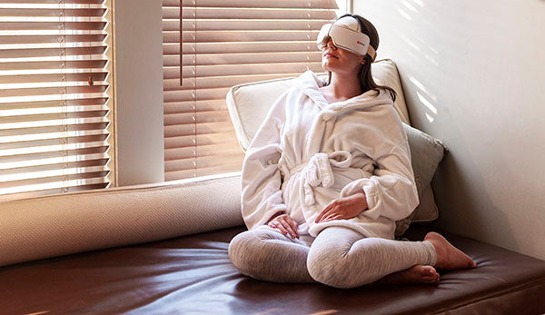 Woman relaxes with the Body Sport Eye Massager