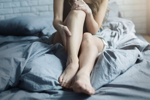 female legs in bed