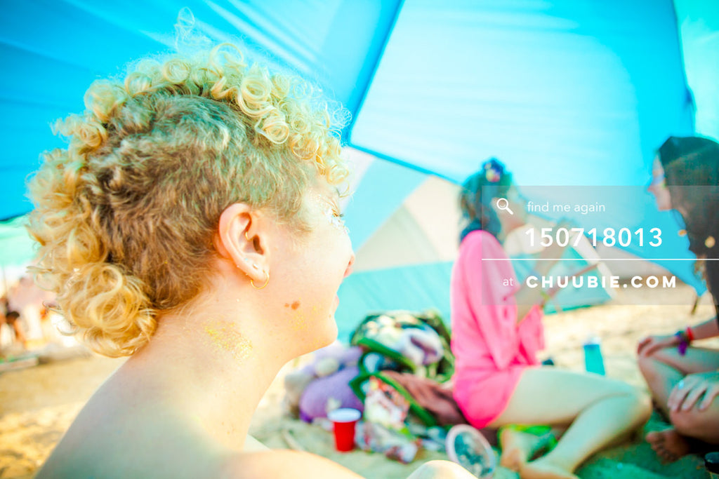 150718013 |  Laughing ladies chatting in colorful blue beach tent. —Gratitude Migration 2015: Summer Dream. M... | Team Chuubie