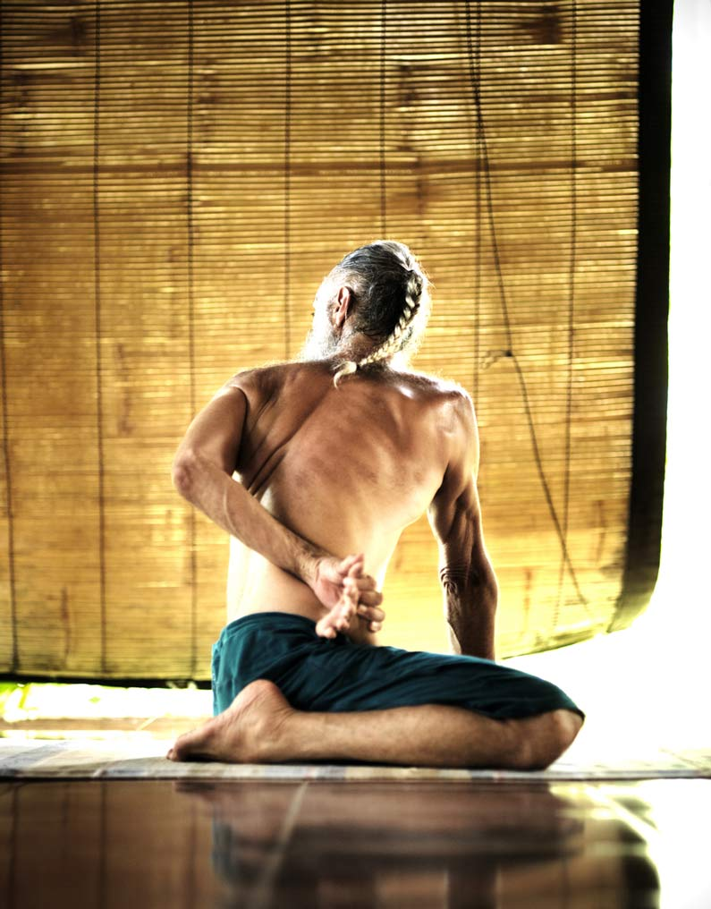 Prem Carlisi in a seated yoga position