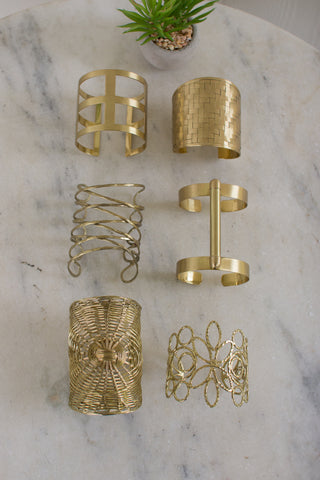 Set Of Six Brass Finish Cuffs