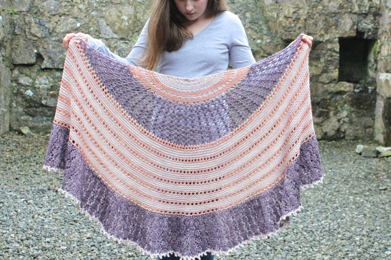 A cosy aran weight knitted shawl: Midnight Sunset