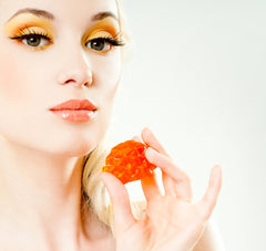 orange makeup is on trend, girl with orange eyeshadow
