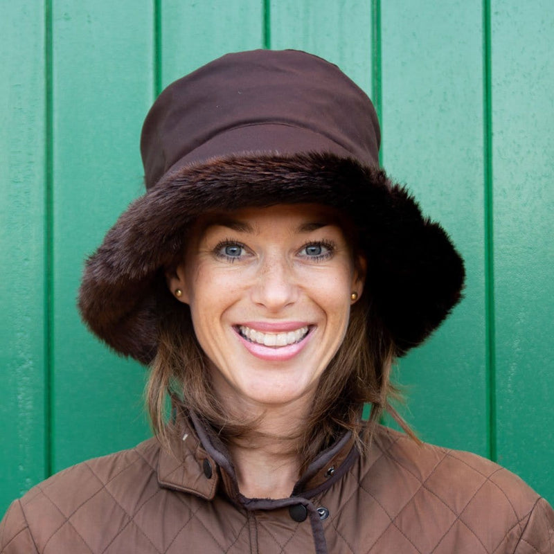 Olney Headwear Beth Ladies Brown Waxed Rain Hat With Faux Fur Trim And Fleece Lining On Woman