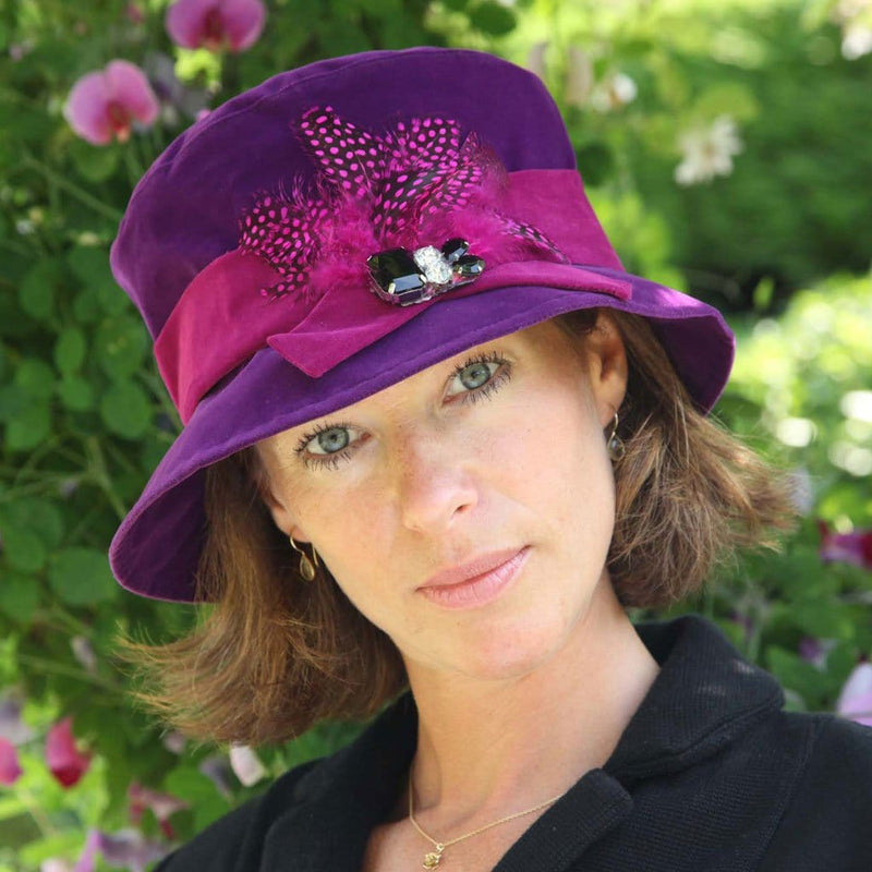 Proppa Toppa PT86 Hannah Purple Cloche Style Rain Hat With Feathers And Jewels Decoration On Woman