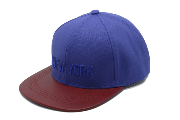 six panel Papa Originals baseball cap with blue cotton canvas crown and red Italian lambskin leather brim and Nueva York embroidery  gorra casquette hat