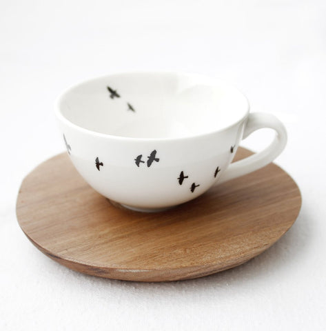 White bird espresso cup with wooden Saucer