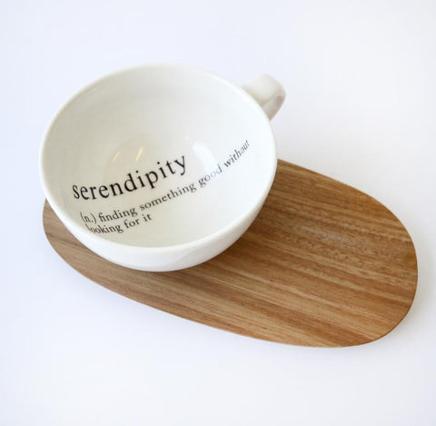 tea cups with message and wooden saucer