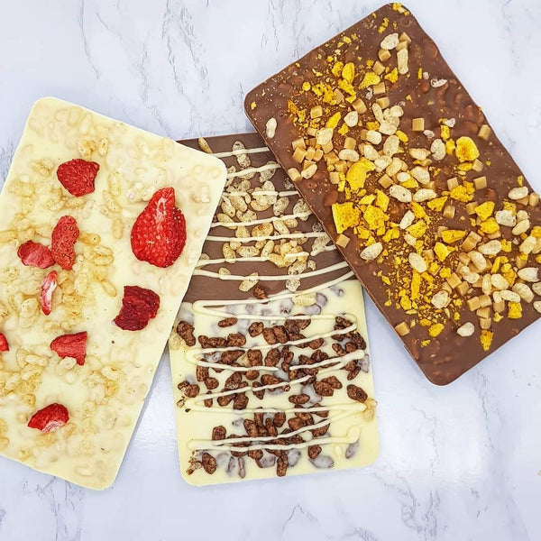 The Honeycomb Fudge Coco Pop Crunch One - The Home Of Fully Loaded boozy Chocolate. Large Slabbs of boozy chocolate with a variety of alcoholic ganaches; gin, rum, whisky, amaretto, baileys and toppings. Available as monthly subscriptions.