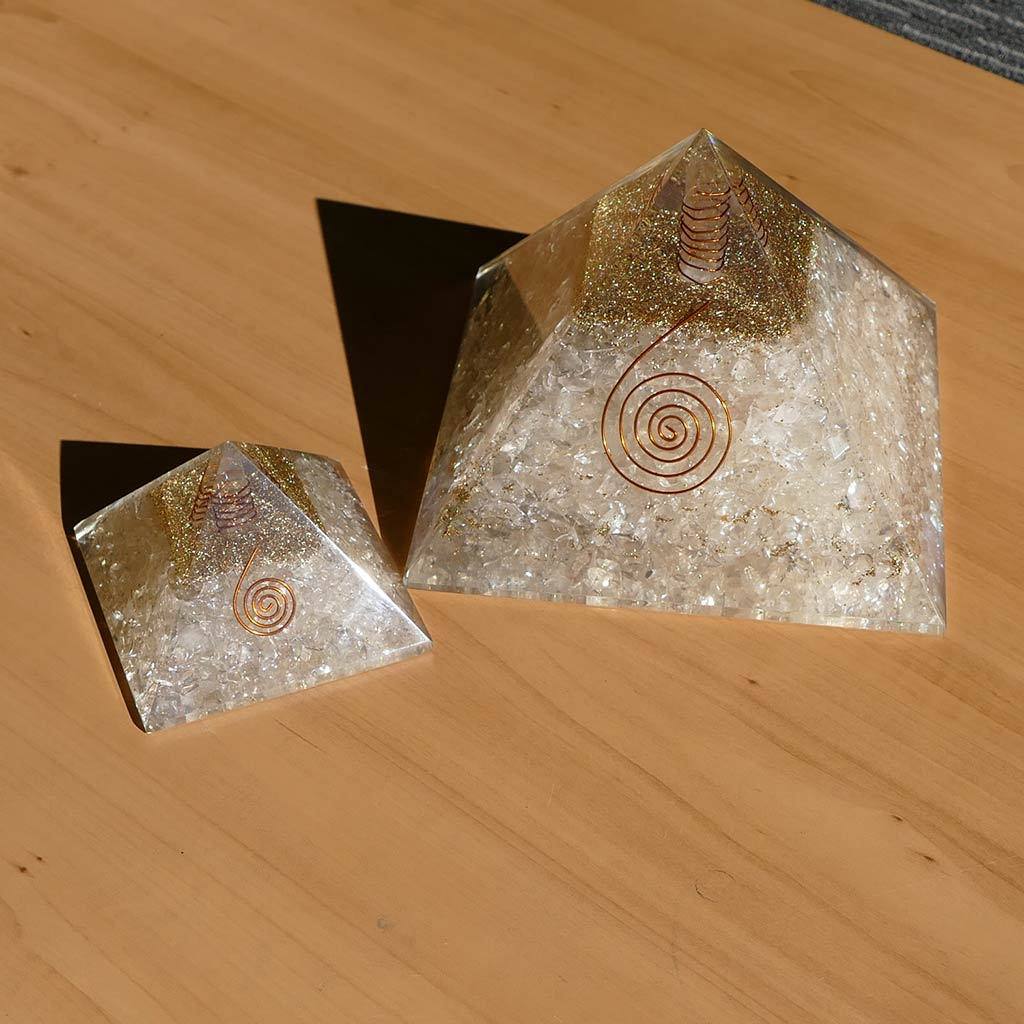 clear quartz orgonite pyramid large and small