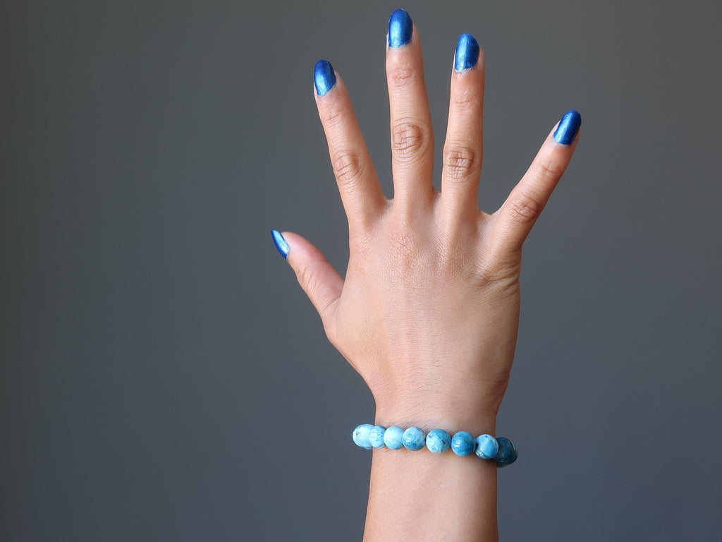 sheila of satin crystals wearing blue apatite beaded stretch bracelet