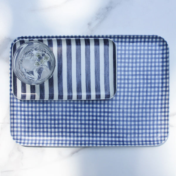 Collection of blue and white linen trays for kitchen, bathroom, bedroom, dining with a French picardie water glass with cilantro flowers