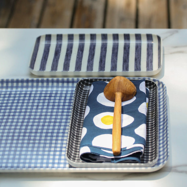 Collection of blue and white linen trays with a blue and white cotton Japanese napkin with hard boiled eggs and a fair trade hand-carved olivewood coffee scoop spoon