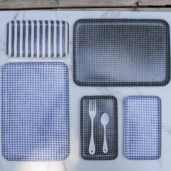 Collection of blue and white linen trays for kitchen, bathroom, bedroom, dining.