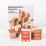 "Wooden blocks in front of a box with the text ""Blockitecture® Factory Architect Building Blocks"""