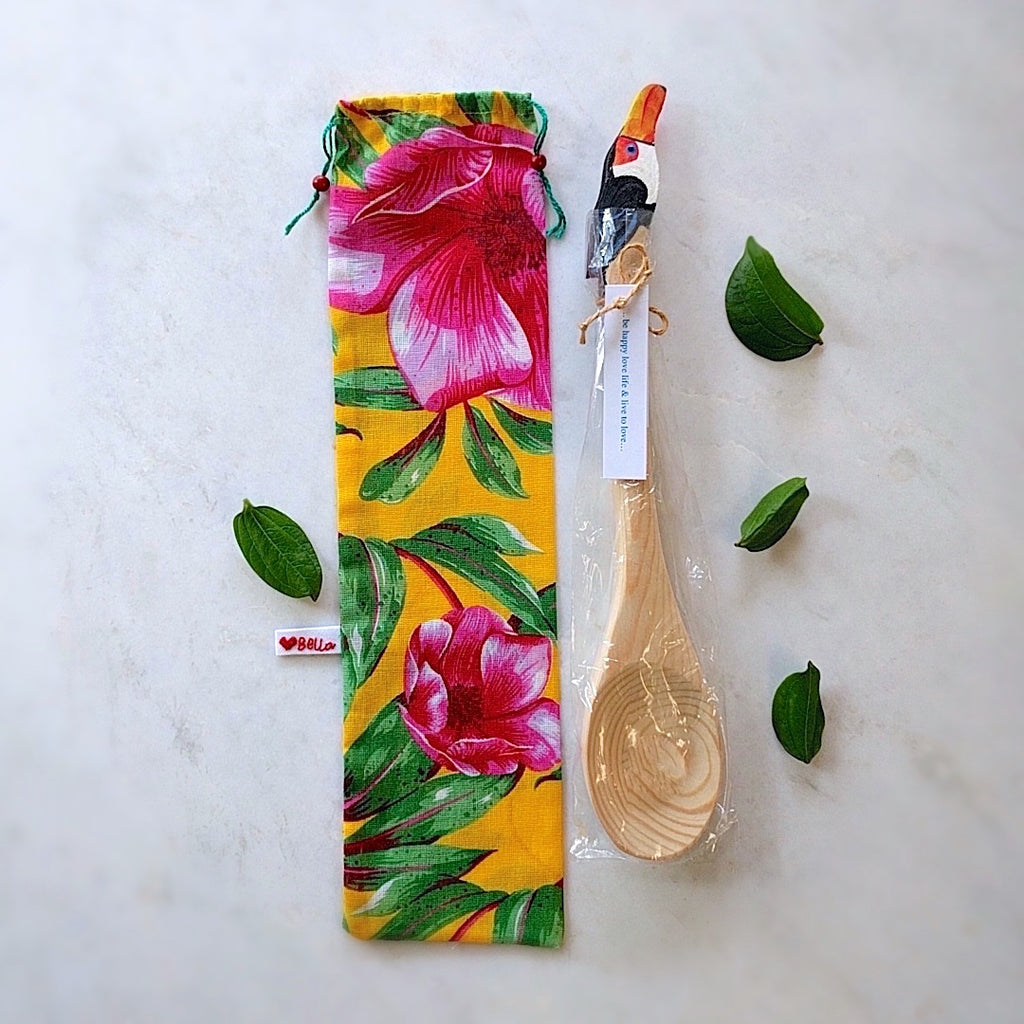 brazilian wood spoon with toucan head here shown with tropics themed gift bag