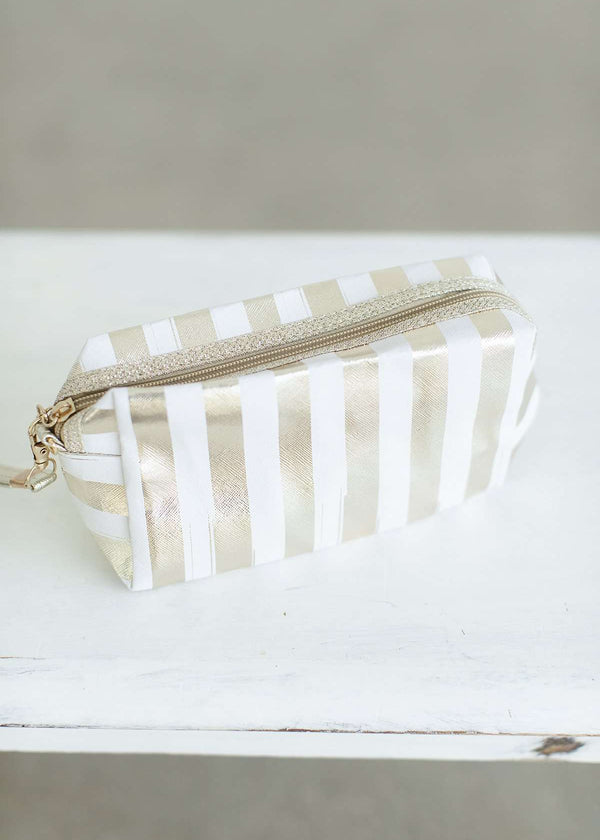 Gold and white striped cosmetic bag