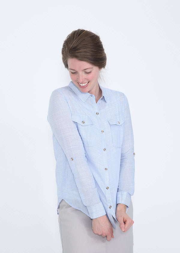 Light blue striped button up blouse paired with a gray below the knee modest skirt