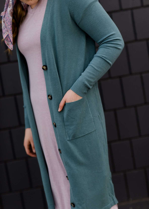 jade colored long double pocket button up cardigan