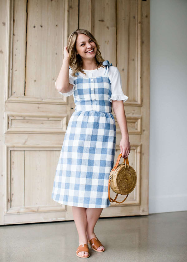 blue and white checkered overall dress