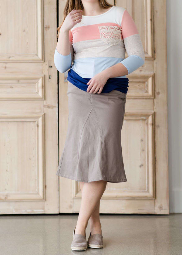 woman wearing a twill khaki a-line style midi skirt with no slit