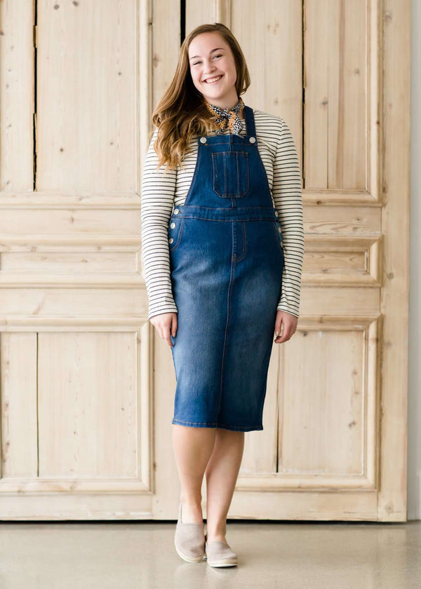 woman in a modest denim overall jumper dress