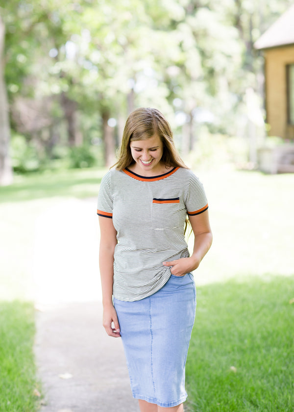 Navy striped tee with a rust accent and front pocket