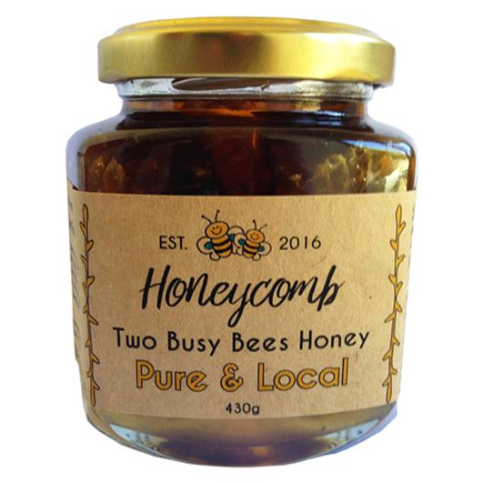 Honeycomb-in-raw-honey-glass-jar-Two-Busy-Bees-Raw-Honey