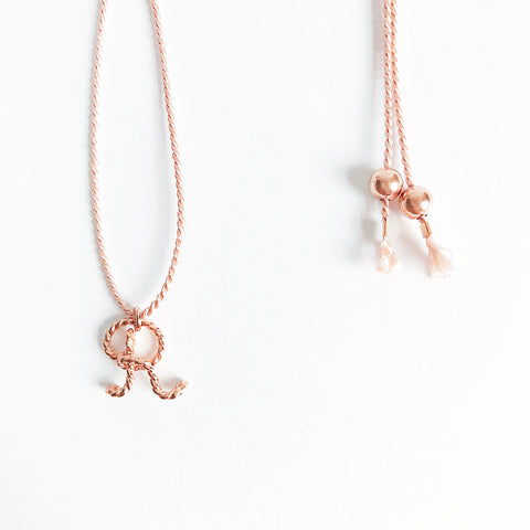 Personalised Initial R Uppercase Calligraphy wire natural light pink silk necklace in 14K rose Gold filled wire handmade by Rachel and Joseph Jewellery in London, UK DETAILS