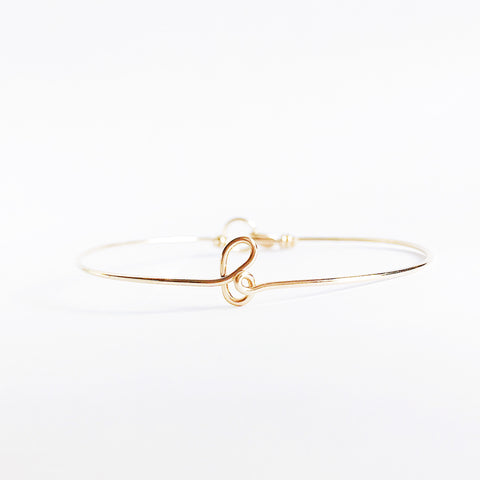 Personalised name initial b wire bangle bracelet in 14K Yellow gold filled handmade by Rachel and Joseph Jewellery in London, UK wb
