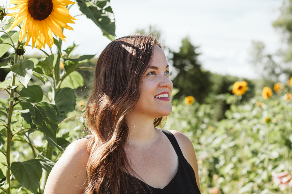 Kristen Runvik in a sunflower field