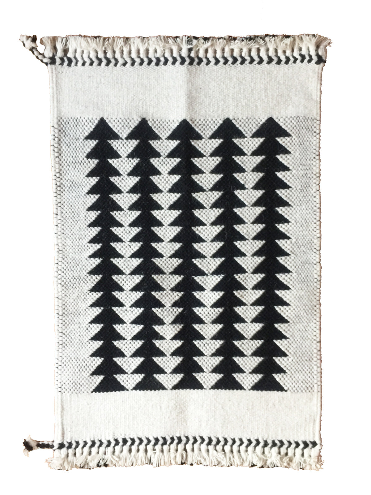 Our bestselling black and white Arrows 2x3' wool rug, handwoven with 100% undyed wool. Black and white wall hanging and area rug.