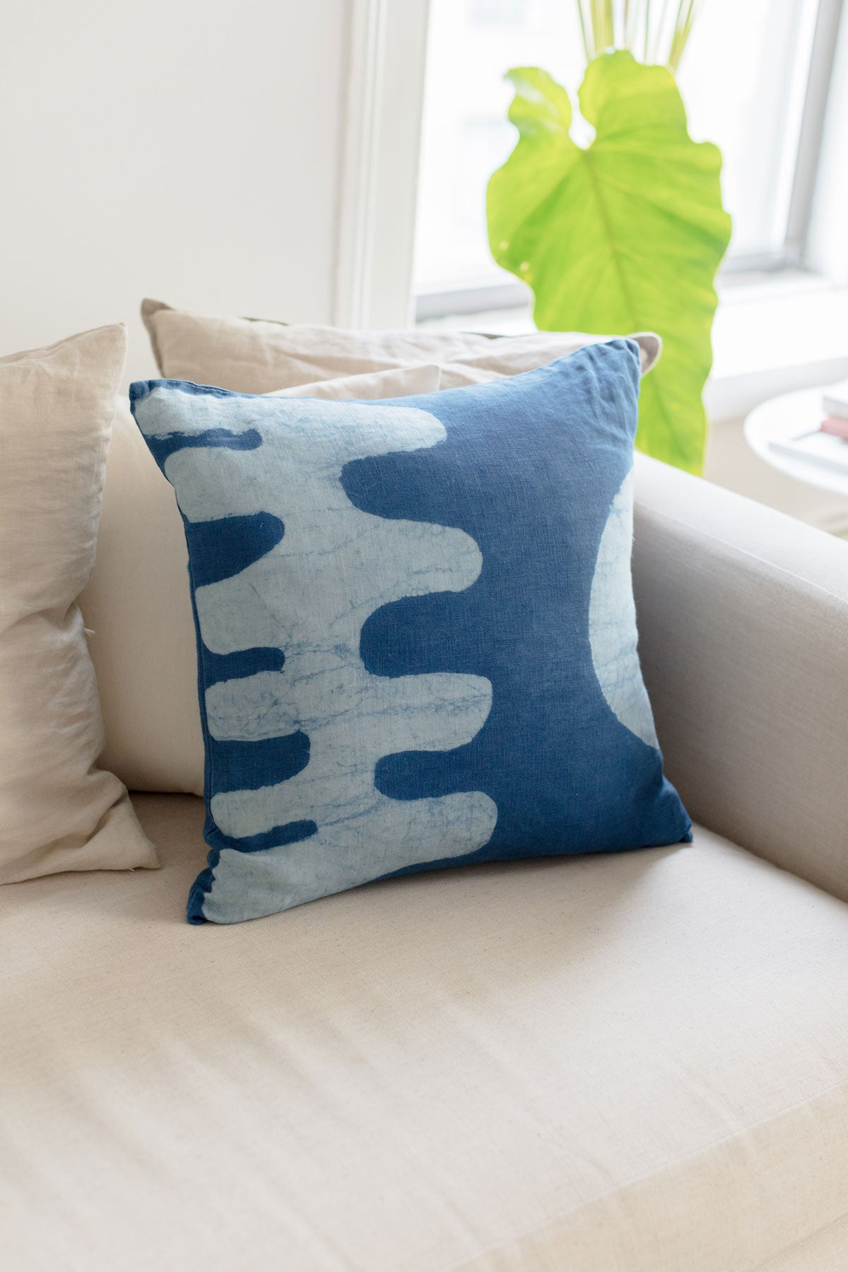 Blue Matisse inspired accent pillow by SUNDAY/MONDAY. Hand block printed and hand dyed with natural indigo. Featuring bold graphic cut out shapes.