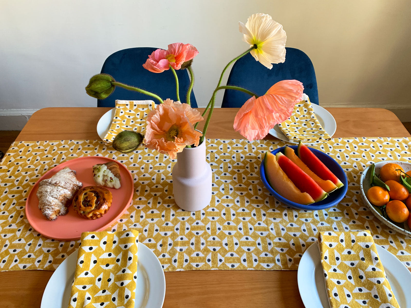 Summery yellow table linens by SUNDAY/MONDAY. Hand block printed geometric pattern in yellow.