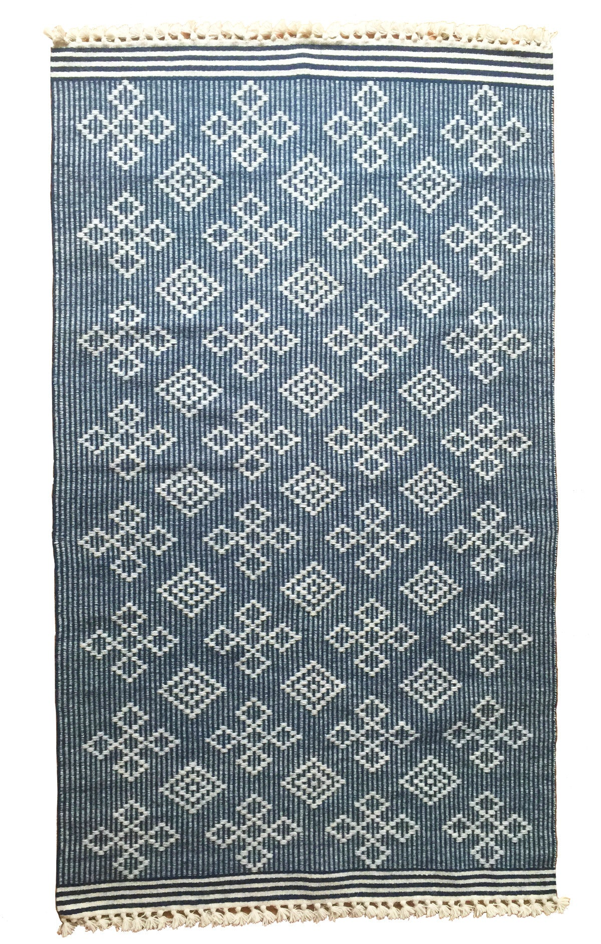 Navy blue flat weave statement rug. Handdyed and hand woven by master weavers in India. Perfect lightweight rug for spring and summer.