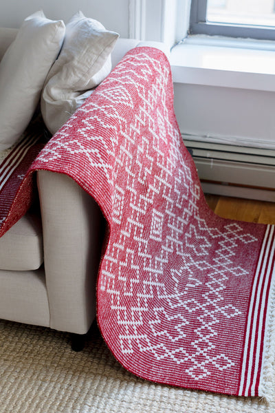 Red and white handwoven wool area rug. A lightweight flatweave with a bold and graphic pattern. Perfect area rug for a bedroom or reading nook.