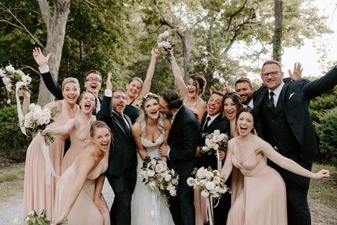 The Kelly's wedding party pose for a fun celebratory photo. Bridesmaids are wearing the Henkaa Sakura Maxi convertible dress in the popular colour Nude Champagne.