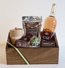 Luxury gift box containing handmade organic chocolate truffles and fudge, a hand poured soy organic candle, a bottle of rose wine from Byron Blatty wines and a Foxgloves & Folly flower jar or succulent pot