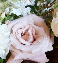 Summer bouquet with white and blush pink flowers and lots of greenery