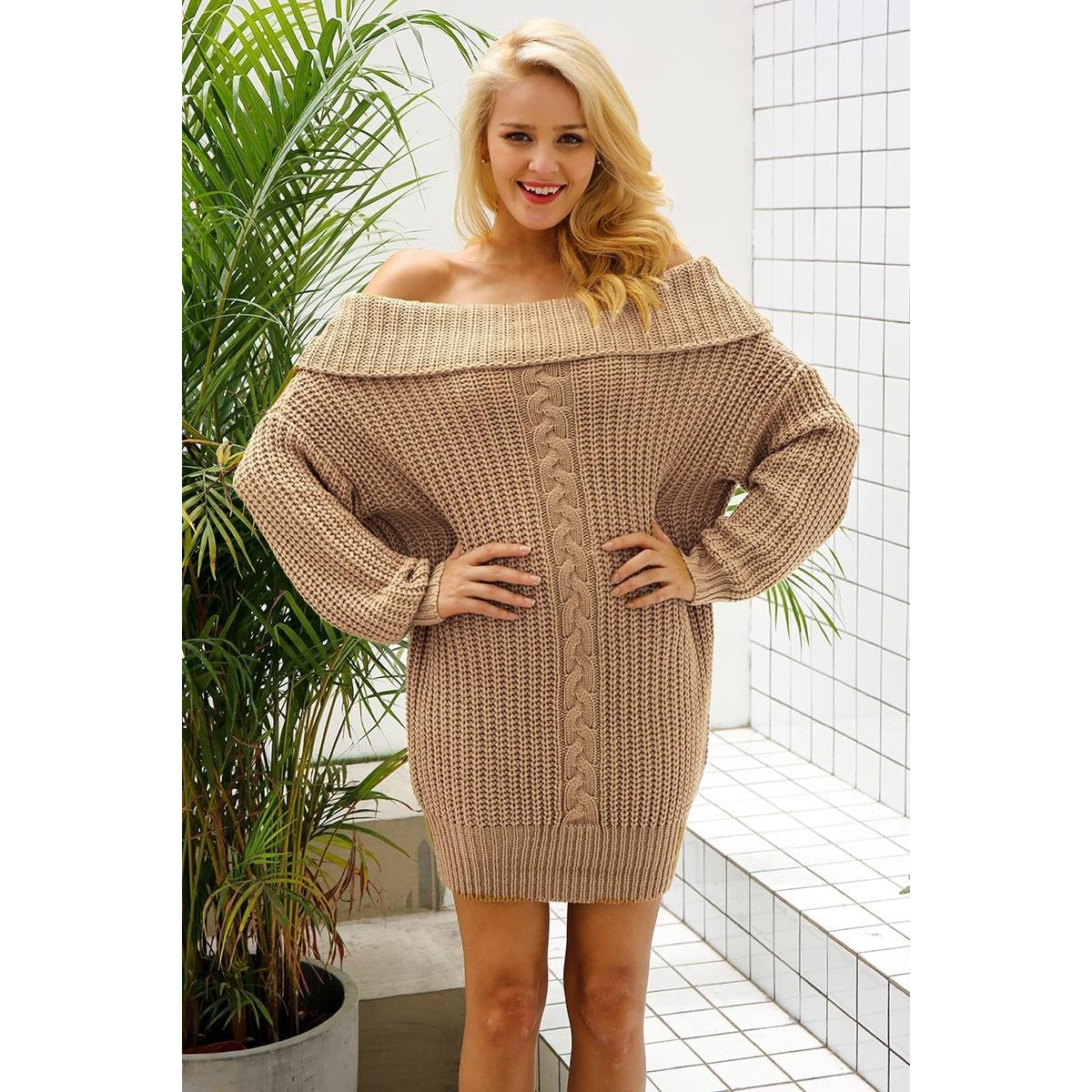 The Amelia Sweater Dress is a one size fits all knit sweater with wide shoulders and hips, plenty of room for stretch and to wear off, cold, or one shoulder style. 2 colors available, khaki and gray.
