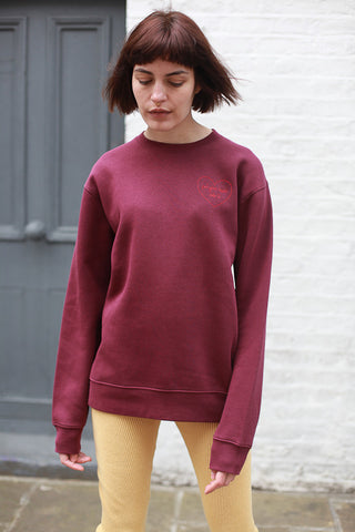 PUT YOUR HEART INTO IT BURGUNDY UNISEX SWEATSHIRT BY THE ENGLISH TEE SHOP