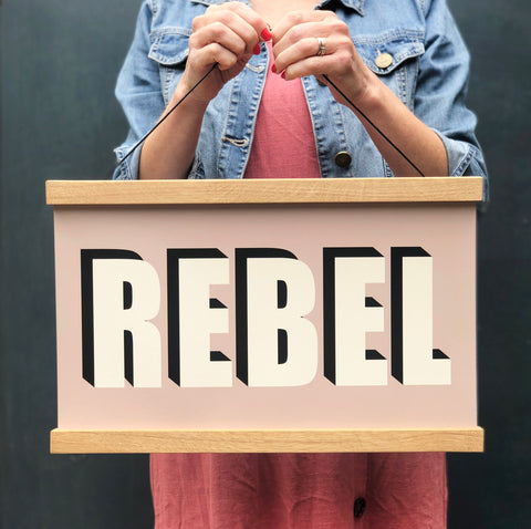 REBEL Hanging Poster Print In Plaster Pink