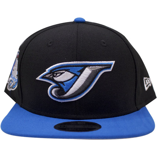 the toronto blue jays 30th season snapback hat has a vintage toronto blue jays logo embroidered on the front with a black crown and a light blue crown