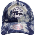 on the front of the acid wash denim Philadelphia 76ers denim dad hat is the Philadelphia 76ers logo in white and navy blue