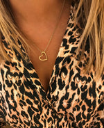 Gold silhouette heart necklace